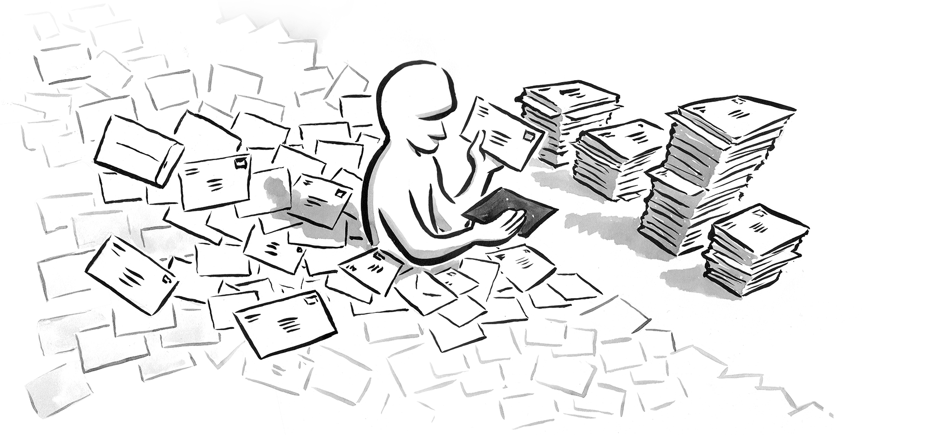 Person immersed in a pile of mail, which they are sorting by hand.