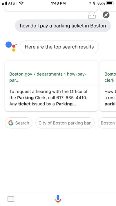 "Google Assistant app on iPhone with the results of a ""how do I pay a parking ticket in Boston"" query, showing results only weakly related to the intended content."